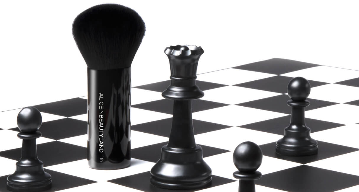 Makeup brush on a chessboard